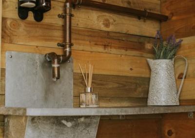 Nomadic Washroom Shepherd Style Feed Trough Sink in their luxury washrooms for wedding hire in the UK.