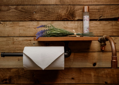 Flowers, scented sprays and rustic fixtures for shepherd hut toilet hire at Nomadic Washrooms.