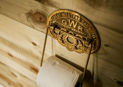 Great Western Railway golden toilet roll fixture for shepherd hut decoration.